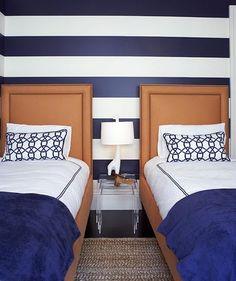 Bold navy + orange bedroom