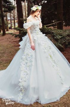 Obsessed with this dreamy floral inspired white gown from Tiglily