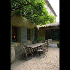 """A charming corner for dining alfresco at a garden in Provence designed by Dominique Lafourcade. So much to love in this image, cantilevered wisteria…"""