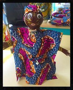 Poupées africaines à partir d'une bouteille de lait.