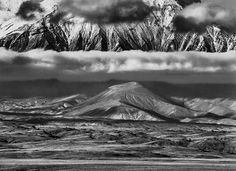 Russia, 2006 A tundra valley extends between Tolbachik and Kamen volcanoes in the Kamchatka Peninsula. A line of clouds separates a 2,600-foot crater from the huge base of Kamen volcano, which rises 15,000 feet above sea level. Sebastião Salgado