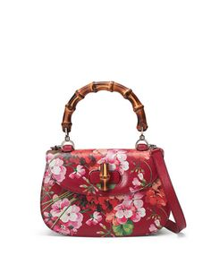"Gucci blooms print leather top-handle bag with silvertone hardware. On mould construction. Hand-painted edges. Bamboo handle, 6"" drop. Adjustable leather shoulder strap, 19"" drop. Bamboo turn-lock clo"