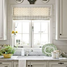 Cottage Makeover | Kitchen Backsplash | SouthernLiving.comAs for a backsplash, wooden plank walls (instead of tile) keep the style of the room seamless and add old-fashioned charm. for AN