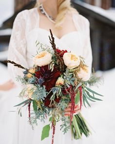 Tiffany and Nic braved the Colorado Rocky Mountains for their February soirée. She clutched an abundant arrangement of greenery, ranunculus, hanging amaranthus, and roses from Statice Floral for the ceremony.