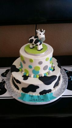Cow themed baby shower cake  by Cucamonga Cakery