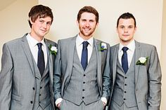 Grey Suit with navy polka dot tie to match bridesmaids