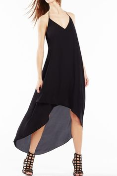 Sleeveless cascading high-low hemline and lace trim on the exposing racerback in pullover style.   Black High-Low Dress by BCBG Max Azria. Clothing - Dresses - LBD Back Bay, Boston, Massachusetts