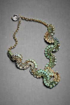 This necklace is a work of art.  The colors remind me of a dreamy ocean.