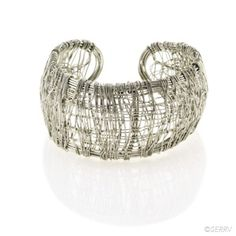 Wrapped Cuff  Fine wire strands are wrapped vertically and horizontally to give this everyday cuff plenty of texture and a sense of movement. Nickel-plated brass wire; expands slightly for some adjustment. 8 1/4 in. l x 1 1/2 in. w