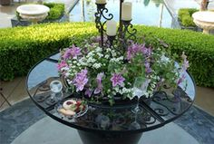 The Ledge - small table tops that hook onto a pot great idea for an outdoor space