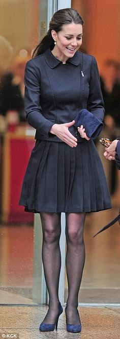 The Duchess's navy ensemble gave her a sophisticated look & her warm and friendly personality seems to put everyone at ease.