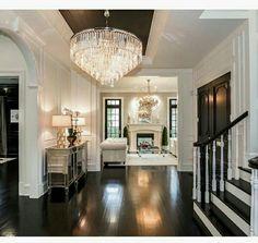 Exquisite Entryway with warm dark wood flooring
