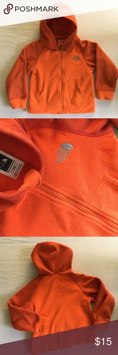 The North Face Fleece Zip Up Hoodie 2T Orange Layering up your little guy has never been easier with this Fleece, two-toned Orange zip-up hoodie that features a cozy split kangaroo hand pocket and North Face Logo on front. Size 2T in good condition. Shows normal wear, no holes, smoke free home. North Face Shirts & Tops Sweatshirts & Hoodies