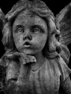 angel blowing a kiss...Gate of Heaven Catholic Cemetery; Burlington, ON.