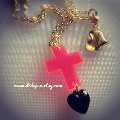 Neon cross necklace with black plastic heart by didepux on Etsy, €7.00