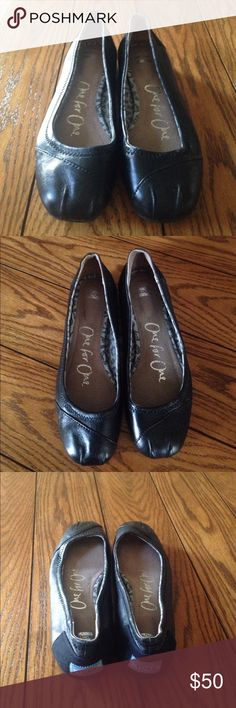TOMS Black leather ballet flats Jet black leather TOMS ballet flats. Excellent condition only worn a few times. TOMS Shoes Flats & Loafers