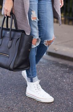 a5b77a560d01 distressed skinny jeans + white high-top Converse sneakers + black Celine  tote