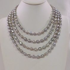 Check out this item in my Etsy shop https://www.etsy.com/listing/208514749/4-strand-silver-baroque-freshwater-pearl