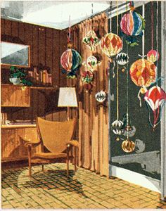 Mid-century Christmas... Large hanging ornaments in front of the windows