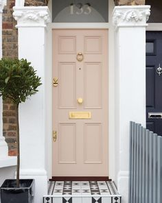 This pretty pink front door and frame with triple wood panel and opaque fanlight. - This pretty pink front door and frame with triple wood panel and opaque fanlight detail is in a typ - House Design, Door Design, House Front Door, House Front, Victorian Door, Victorian Front Doors, House Exterior, Door Furniture, Pink Front Door