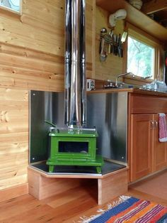 Heat source in tiny house. I think it would save space to have the heating source also be the cooking source- a wood or coal stove. AND ITS SUPER CUUUTE