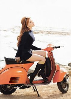 #sexyredhead on Scooter/ Vespa in orange