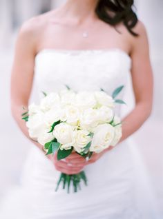 Creamy white rose bouquet: http://www.stylemepretty.com/2016/07/14/forget-catching-pokemon-catch-these-wedding-bouquets-instead/