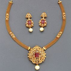 Gold necklace with uncuts and ruby pendant and earrings