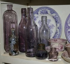 Purple glass bottles from recent travels.