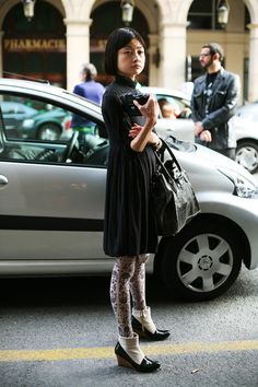 street fashion. love patterned tights/leggings. the jury's still out on faux-sock boots.