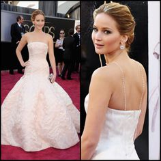 Most people think of the Marilyn Monroe white dress; however, the Marilyn Monroe dress is overdone and not appropriate for a black tie event. Instead try an iconic red carpet look, like Jennifer Lawrence's Oscar 2013 look.