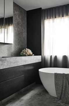A rich and moody bathroom design by Sally Caroline. Photo by Dan Hocking.