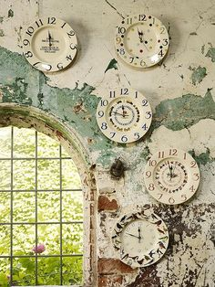 "magicalhome: "" Love that wall and the way the colors in the clocks compliment it. """