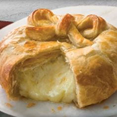 Puff Pastry-Wrapped Brie - Three simple steps are all you'll need to make this simply delicious and elegant appetizer, featuring golden puff pastry oozing with melted Brie cheese.