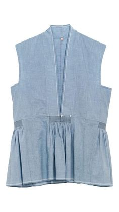 "</p> Top with oriental cut and silhouette, with lateral panels in light blue handloomed cotton. Stitches in contrasting colour on lateral bottom waist. V neck shape collar. Closure with small mother of pearl button. For extra layering, style it with a light linen shirt underneath, or a comfortable knitted cardigan.</p> 100% Cotton</p> <p class=""p1"">"