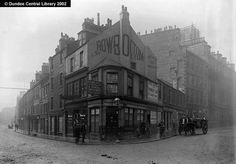 This photograph shows Dundee's Panmure Street leading westwards to the right (towards Meadowside) and the Murraygate leading off to the west (towards the High Street). George Henry Rowbottom, clothier and general outfitter, is listed in Dundee Directories ate Nos. 33 and 35 Panmure Street only after 1892-93. The sign referring to 'extension and reconstruction of premises' therefore helps to date the image. His shop was previously only No.150 Murraygate. Rowbottom lived at Rowanbank in…
