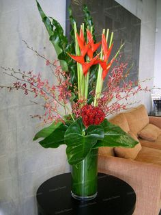 Orlando Flowers - exclusive floral creations for any occasion - weddings, corporate events, etc. Tropical Vases, Tropical Bathroom Decor, Tropical Floral Arrangements, Tropical Flowers, Purple Flowers, Coconut Flower, Coconut Leaves, Hotel Flower Arrangements, Vase Arrangements
