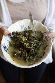 Lonnée's Collards  2 tbsp. extra-virgin olive oil   2 tbsp. unsalted butter   3 cloves garlic, roughly chopped   2 small yellow onions, minced   5 cups chicken stock   1 1⁄2 lbs. collard greens, stemmed      and roughly chopped   Kosher salt, freshly ground black      pepper, and crushed red chile flakes,      to taste