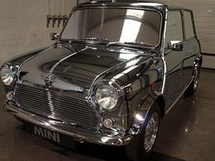 A very shinny silver classic Mini Cooper. Classic Mini, Mini Cooper Classic, Mini Cooper S, Classic Cars, David Bowie, Retro Cars, Vintage Cars, Mini Morris, Exotic Cars