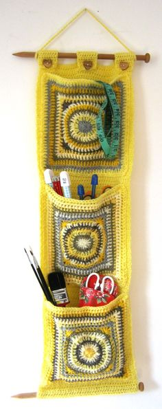 Crochet Pattern for Hanging Wall Pockets for toys or craft storage. Think we should do these. Like the needles top and bottom.