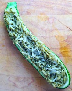 Toss cooked orzo with pesto. Spoon mixture into zucchini and top with grated Parmesan. Bake at 425 degrees F until tender, 20 to 25 minutes.