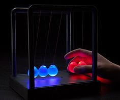 Kinetic Light Cradle http://www.thisiswhyimbroke.com/kinetic-light-cradle