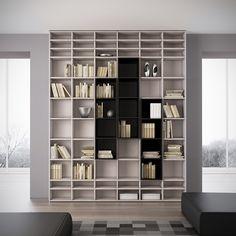 Biblioteca Planejada com Nichos em Várias Medidas e Acabamentos Diferentes. http://www.moradamoveis.com/