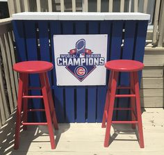 My easy DIY backyard outdoor pallet bar. Chicago Cubs themed. Paint from Home Depot MLB  collection. Chicago blue painted on the pallets and Chicago red on the stools. 2 pallets with 3 stepping stones for the bar top. Painted white with cement paint.