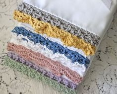 Crochet trims for pillowcases; the pillowcase edge is prepared with size 10 thread, but the rest is worked up in dk-weight yarn.