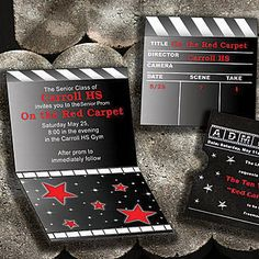 Our Hollywood Clapboard Invitations features the look of a clapboard on the front and a film roll on the inside with red stars.