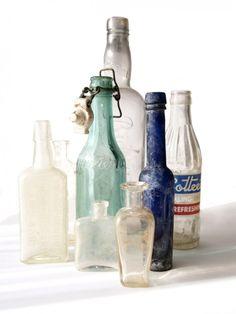 vintage bottles + candles=centerpieces!