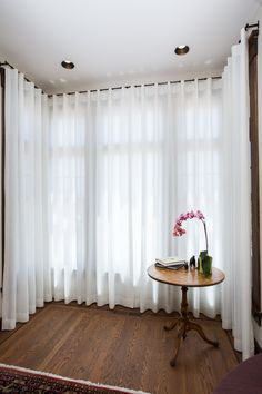 sheer ripple curtains in a square bay