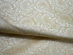 This is a beautiful floral motifs Weaving Brocade Fabric in Gold and Cream . You can use this fabric to make Dresses, Tops, Blouses, Jackets, Crafting, Clutches or Evening Bags, Embellish your clothes, Pillows, Drapery, Home Décor, Outdoor, Quilting, Sewing, General, Upholstery etc use it for scrap booking projects.  Listing for 1 Yard of fabric. Width of the fabric is 44 inches. To view more Cotton Fabric please follow the link : https://www.etsy.com/shop/Indianlacesandfa...