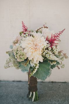 dahlia statement bouquet, photo by Fondly Forever http://ruffledblog.com/intimate-big-sur-wedding #flowers #bouquet #dahlia
